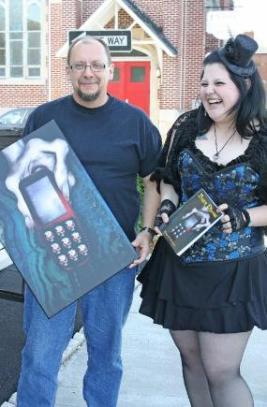 Thomas Malafarina and Alecia Nye presenting her print of the Burn Phone cover.